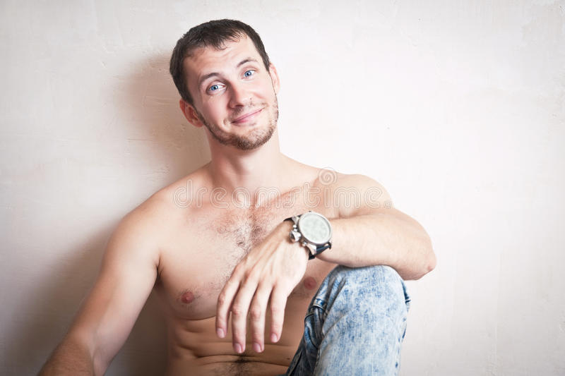Portrait of a smiling handsome man. With naked torso stock images