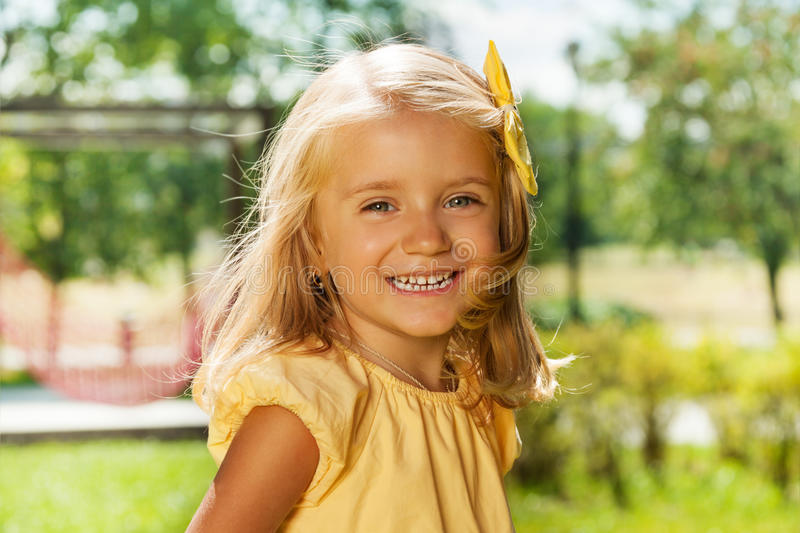 Portrait of smiling happy blond little girl stock photos