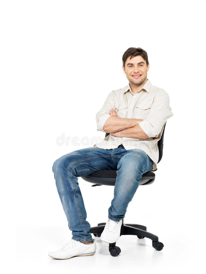 Portrait of smiling happy man sits on office chair stock photography