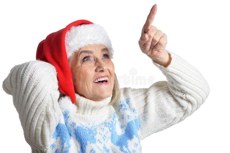 Portrait of smiling happy senior woman in Santa hat posing stock image