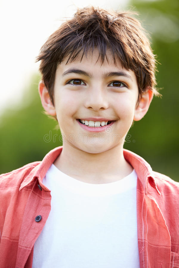 Portrait Of Smiling Hispanic Boy In Countryside royalty free stock photography