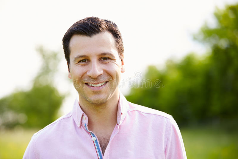 Portrait Of Smiling Hispanic Man In Countryside stock photos
