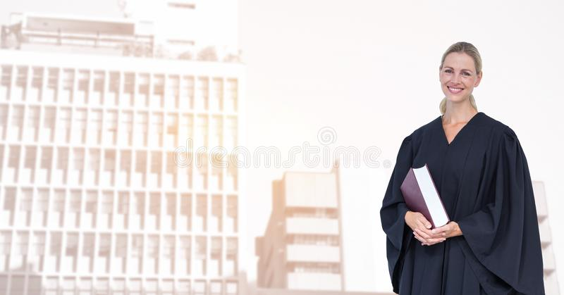 Portrait of smiling judge holding book in city royalty free stock photos