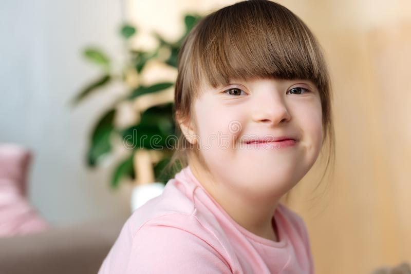 Portrait of smiling kid. With down syndrome stock image