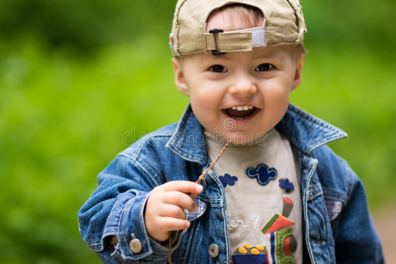A portrait of a smiling little beautiful boy stock photo
