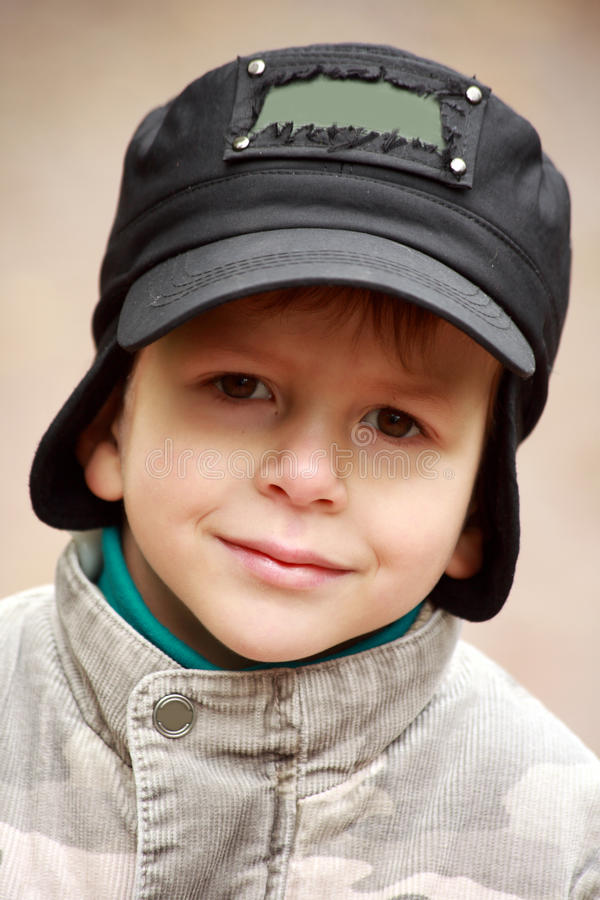 Portrait of a smiling little boy in hat royalty free stock photos