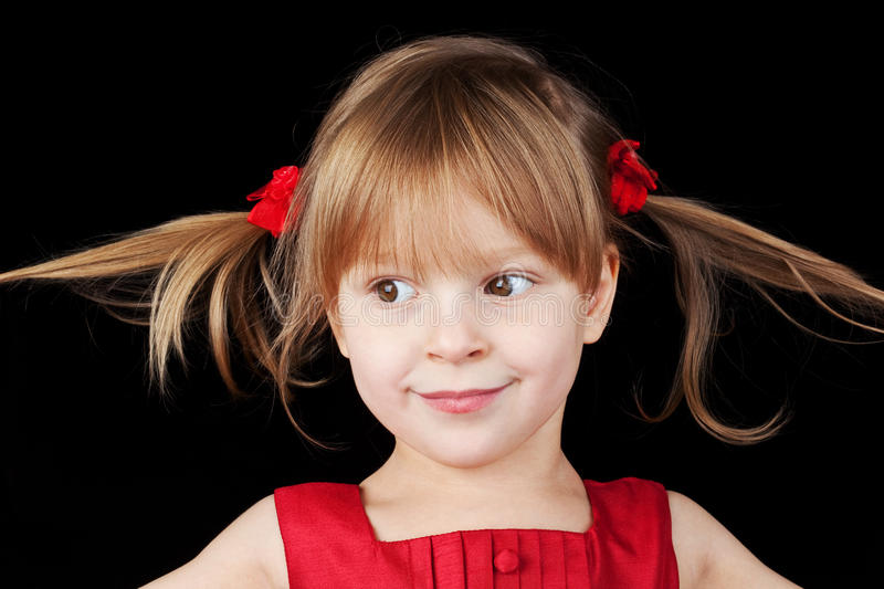 Portrait of the smiling little girl stock photos