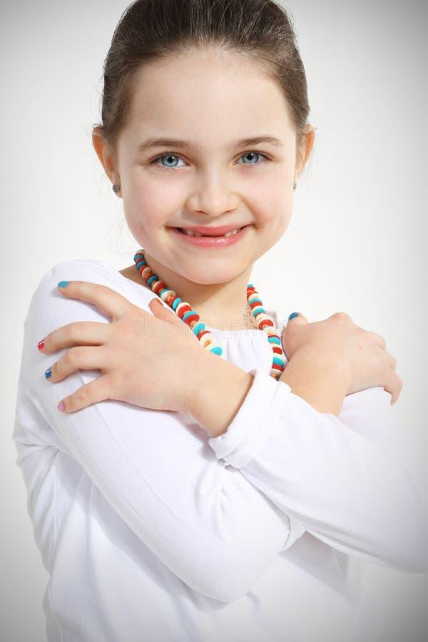Portrait of smiling little girl stock image