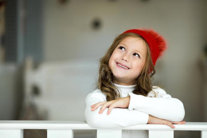 Portrait of smiling little girl. Beautiful little girl celebrates Christmas. royalty free stock images