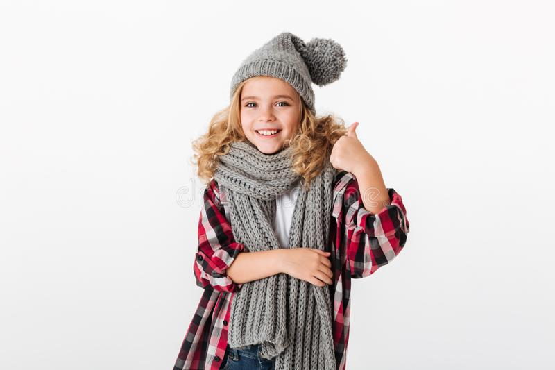 Portrait of a smiling little girl dressed in winter hat royalty free stock images