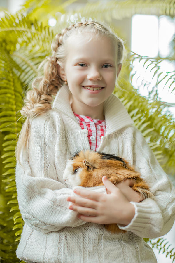 Portrait of smiling little girl posing with pet stock photo