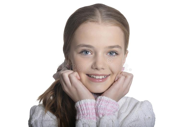 Portrait of smiling little girl wearing warm sweater on white background. Portrait of smiling little girl wearing warm sweater isolated on white background royalty free stock photography