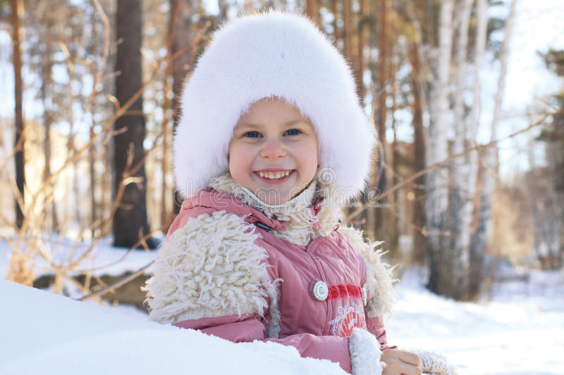 Portrait of a smiling little girl in winter stock photos