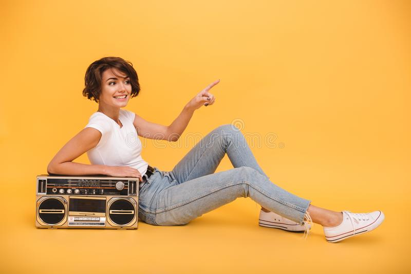 Portrait of a smiling lovely girl sitting with record player royalty free stock photo