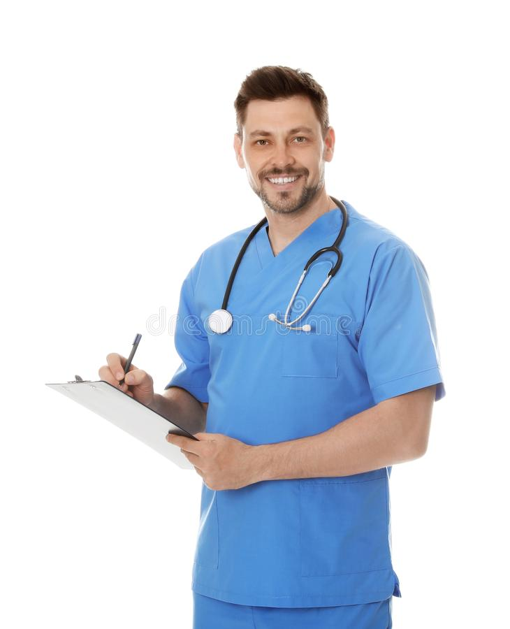 Portrait of smiling male doctor in scrubs with clipboard. Medical staff. Portrait of smiling male doctor in scrubs with clipboard isolated on white. Medical royalty free stock image