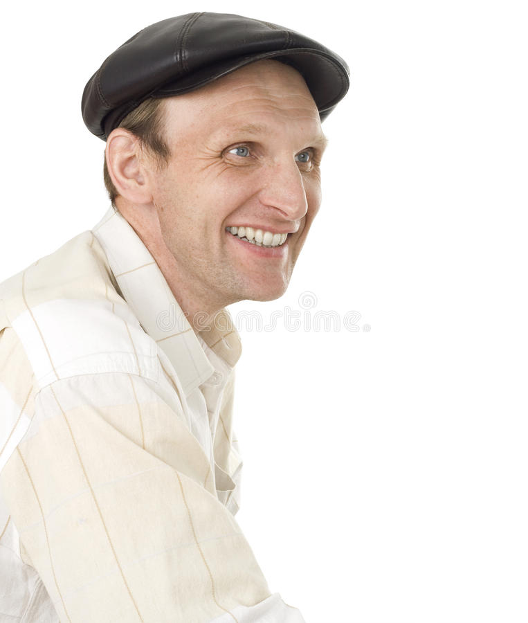 Portrait of the smiling man in a cap royalty free stock image