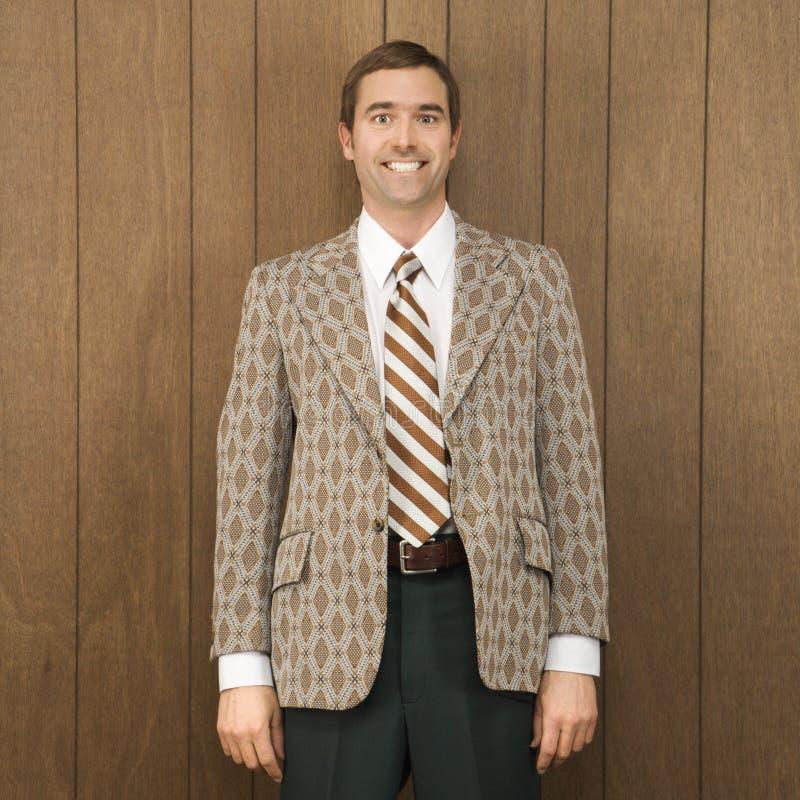 Portrait of smiling man in retro suit stock photos