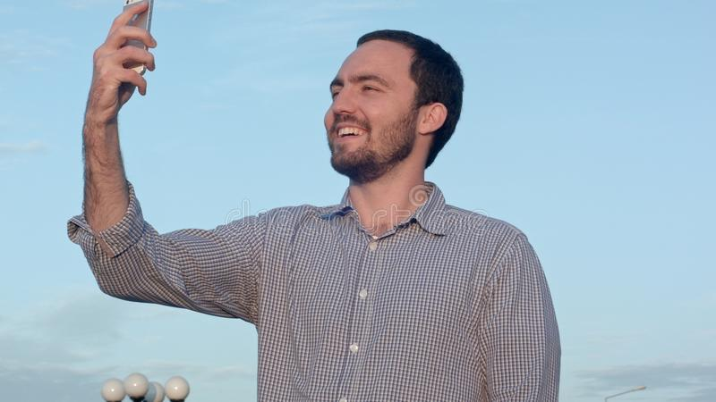 Portrait of smiling man taking photo of himself royalty free stock photo
