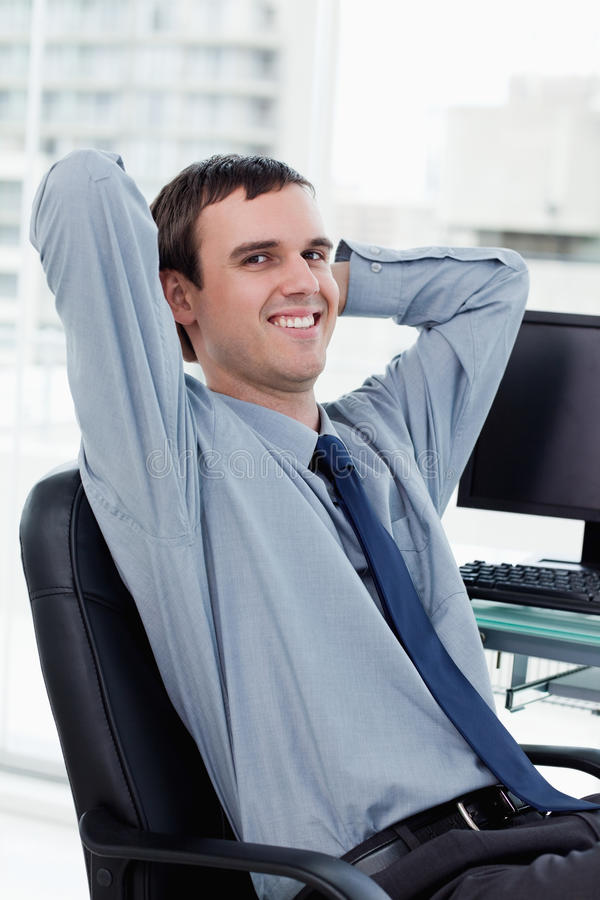 Download Portrait Of A Smiling Manager Relaxing Stock Image - Image: 22693601