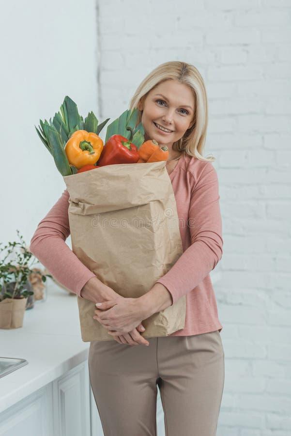 portrait of smiling mature woman stock image