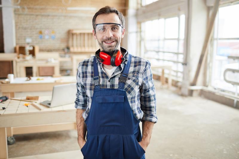 Portrait of Smiling Mature Worker at Factory royalty free stock photography