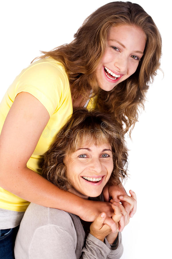 Portrait of smiling matured mum with her daughter stock images