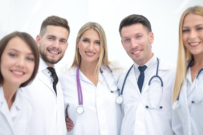 Portrait of smiling medical team. Portrait of a doctor and medical team on white background royalty free stock image