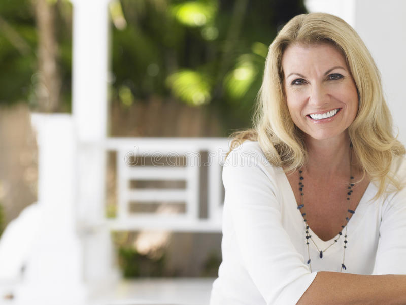 Portrait Of Smiling Middle Aged Woman stock photos