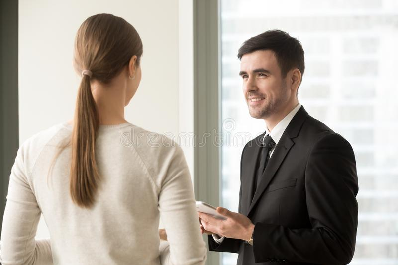 Female and male colleagues meeting in office stock photo