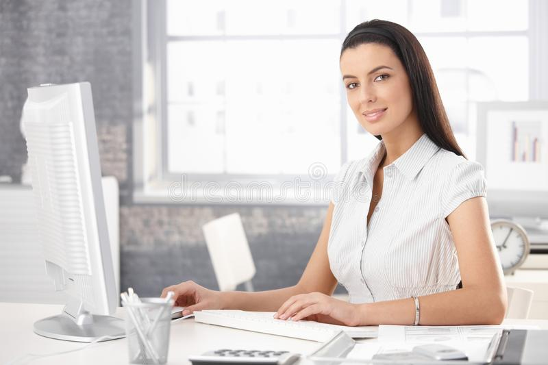 Portrait of smiling office girl royalty free stock photography