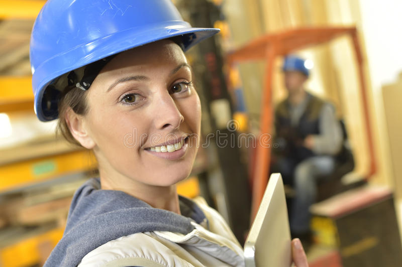 Portrait of smiling operator in warehouse stock images