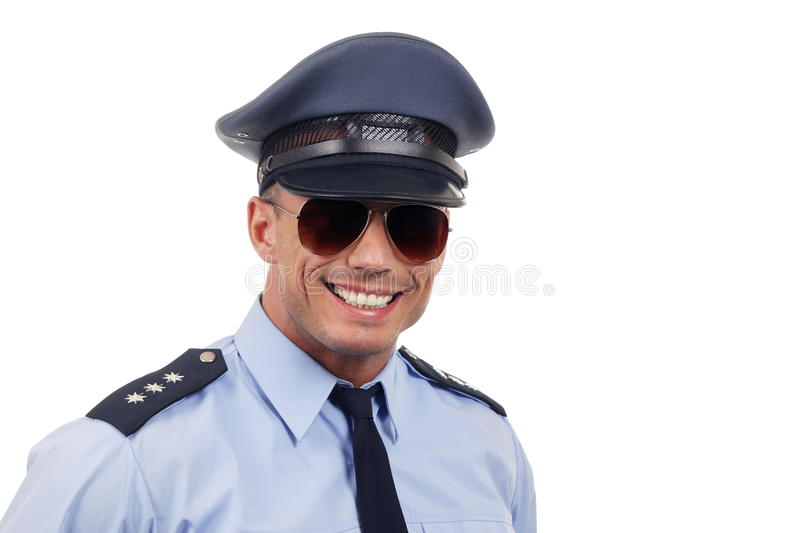 Portrait of smiling policeman stock images