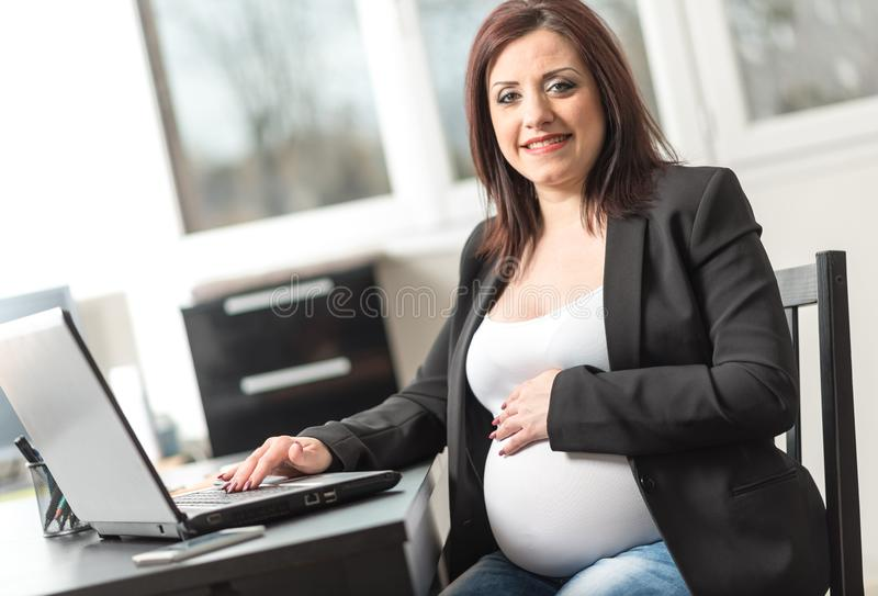 Portrait of smiling pregnant businesswoman royalty free stock photo