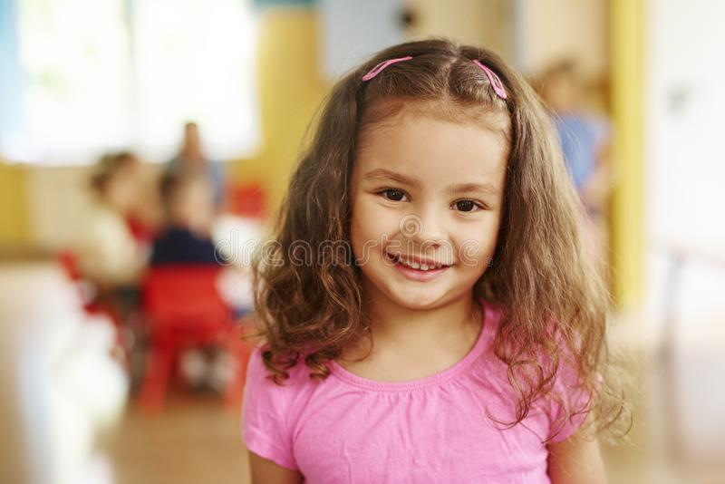 Portrait of smiling preschool girl royalty free stock photography