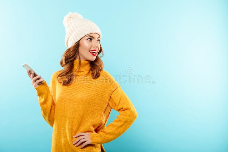 Portrait of a smiling pretty girl holding mobile phone royalty free stock photography