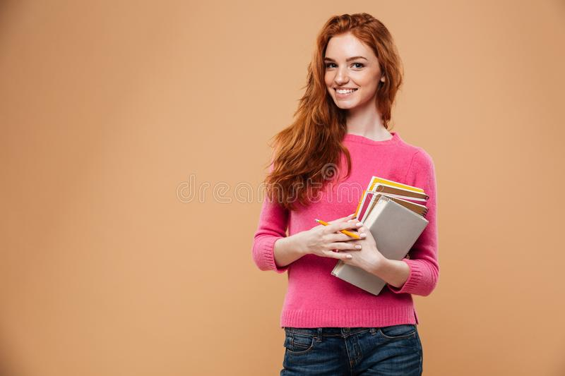 Portrait of a smiling pretty redhead girl stock image