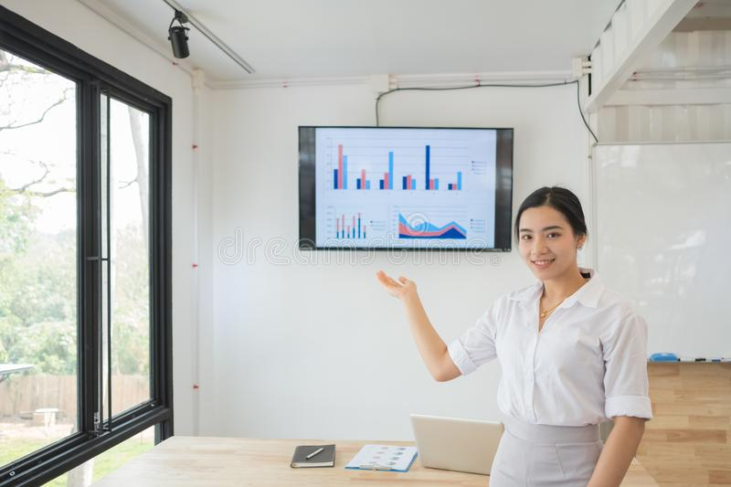Portrait of smiling pretty young business woman on workplace, royalty free stock photography