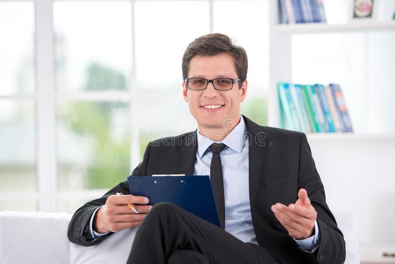 Portrait of smiling psychologist in office stock photo