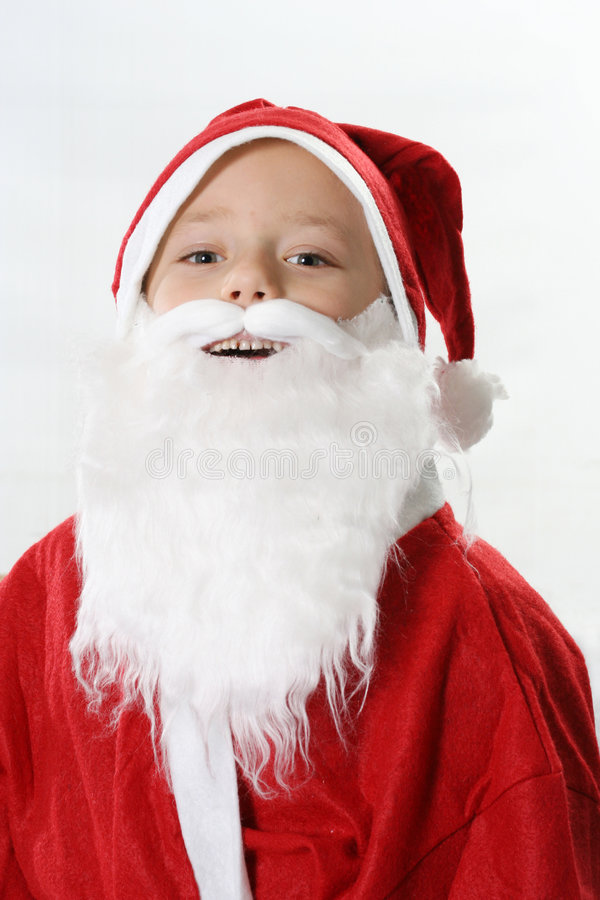 Portrait of a smiling Santa. Portrait of a smiling boy in cap Santa in a white beard stock photos