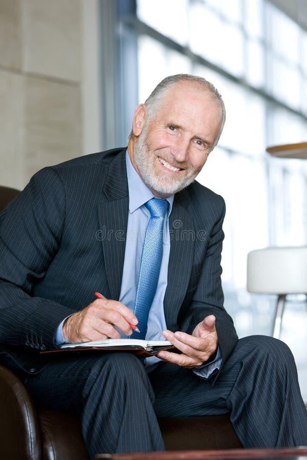 Portrait of smiling Senior business man stock photo