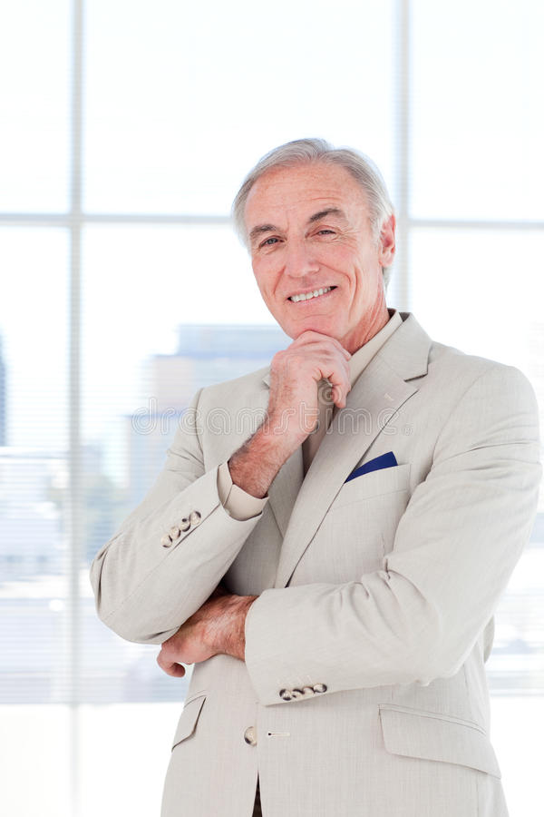 Portrait of a smiling senior businessman stock image