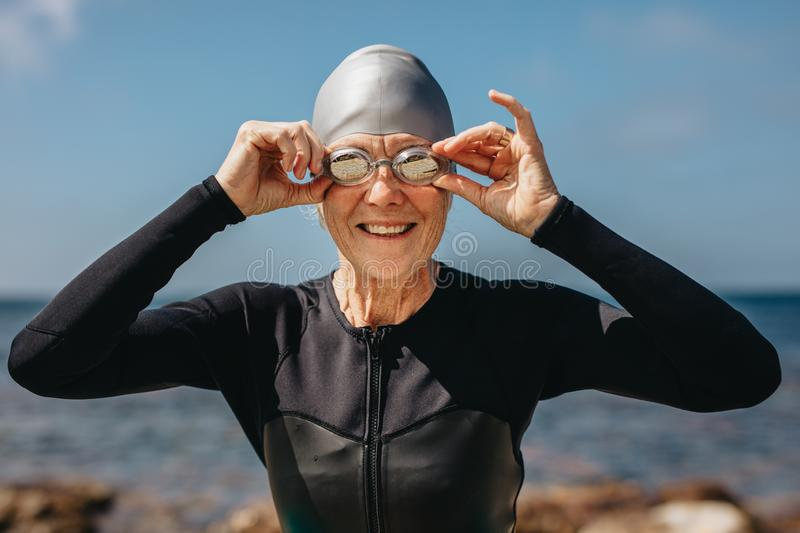Senior woman enjoying a swim at the sea royalty free stock photo