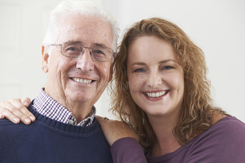 Portrait Of Smiling Senior Man With Adult Daughter royalty free stock images