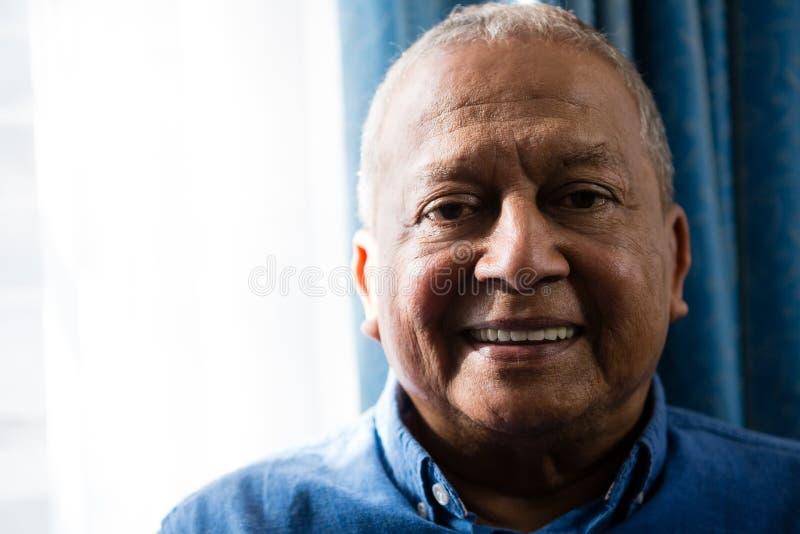 Portrait of smiling senior man stock photos