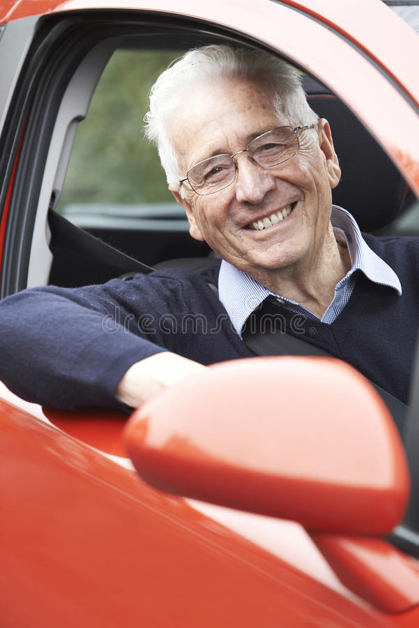 Portrait Of Smiling Senior Man Driving Car. Smiling Senior Man Driving Car stock photo