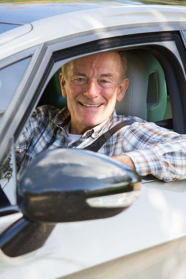Portrait Of Smiling Senior Man Driving Car. Smiling Senior Man Driving Car royalty free stock image