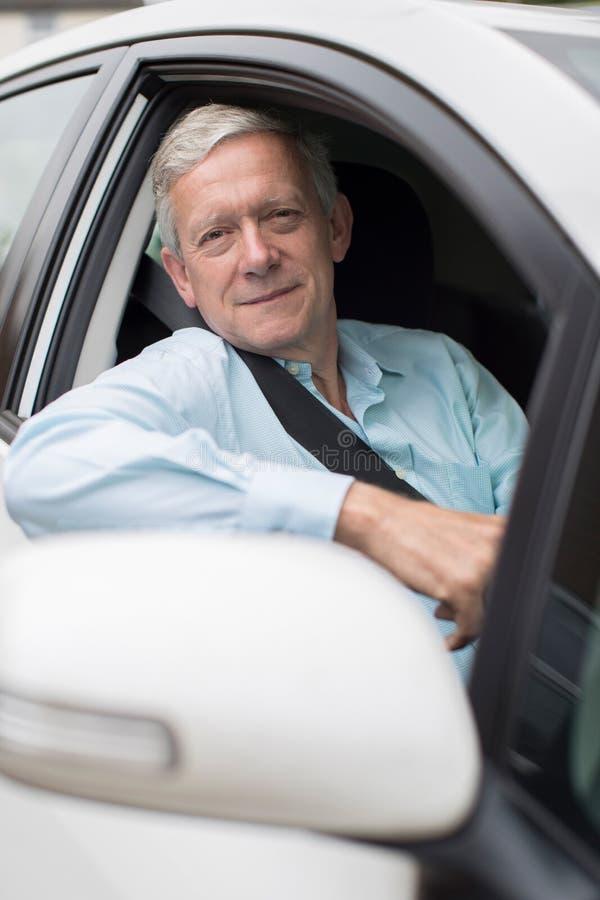 Portrait Of Smiling Senior Man Driving Car. Smiling Senior Man Driving Car stock photos