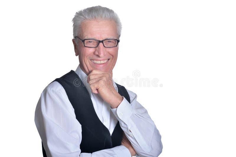 Portrait of smiling senior man on white background stock photos