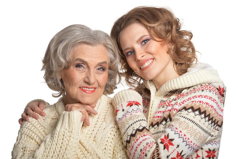 Portrait of smiling senior mother and her daughter stock image