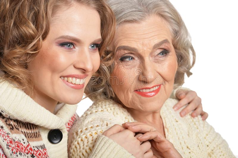Close up portrait of smiling senior mother and her daughter stock photography